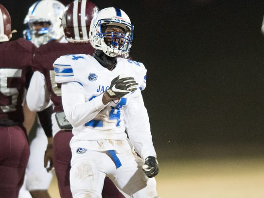 Marcus Middleton celebrates a tackle during the MHSAA