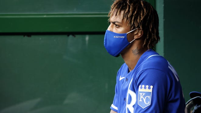 Masks in the dugout and regular COVID-19 tests is part of baseball's new routine.