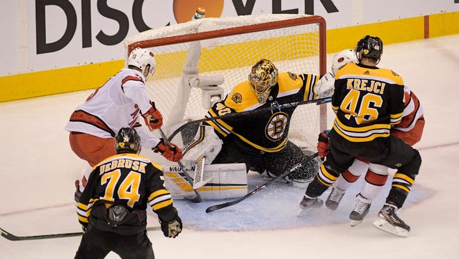 Bruins goaltender Tuukka Rask blocks the shot of Hurricanes left wing Warren Foegele during the second period in Game 2 of the first round of the 2020 Stanley Cup Playoffs at Scotiabank Arena in Toronto.