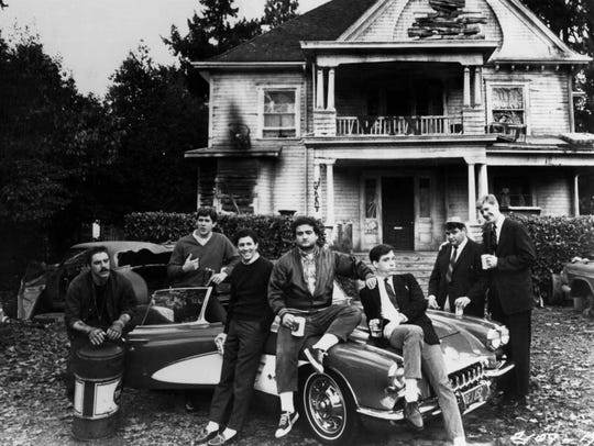 """The brothers of Delta Tau Chi pose outside their fraternity house in """"Animal House."""""""