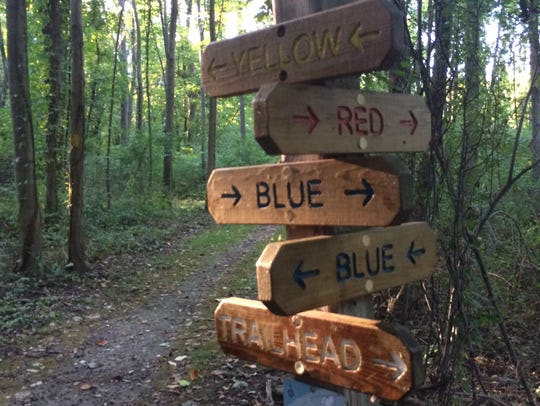 A sign marks several trails at Whiting Road Nature