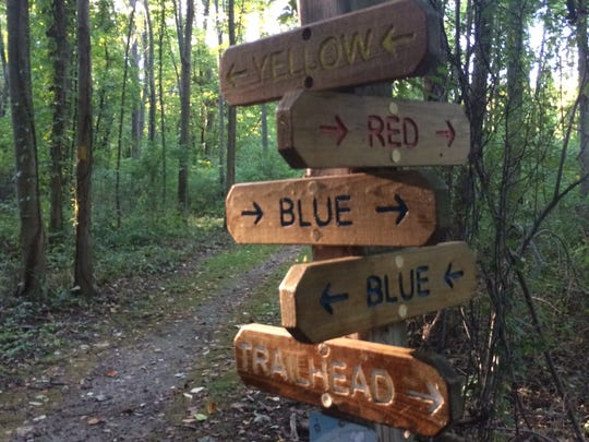 A sign marks several trails at Whiting Road Nature Preserve in Webster, which has 3.5 miles of trails.