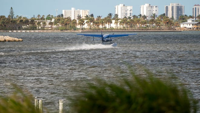 A seaplane lands in the Indian River Lagoon after a low-level run over the proposed landing area at the Causeway Cove Marina on Thursday, Oct. 19, 2017, in Fort Pierce.