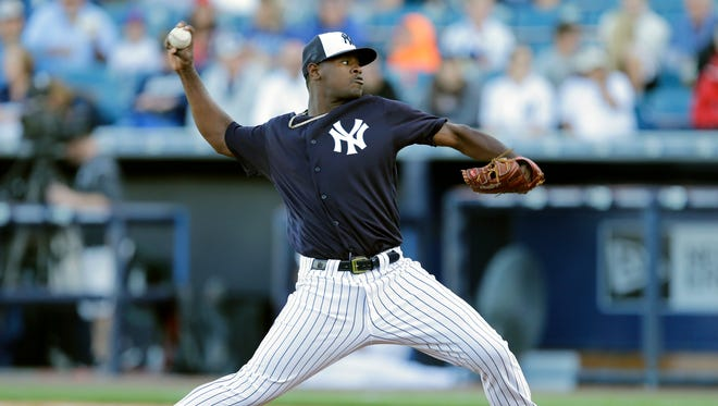 New York Yankees starting pitcher Luis Severino delivers to the New York Mets during the first inning of a spring training baseball game Tuesday, March 22, 2016, in Tampa, Fla.