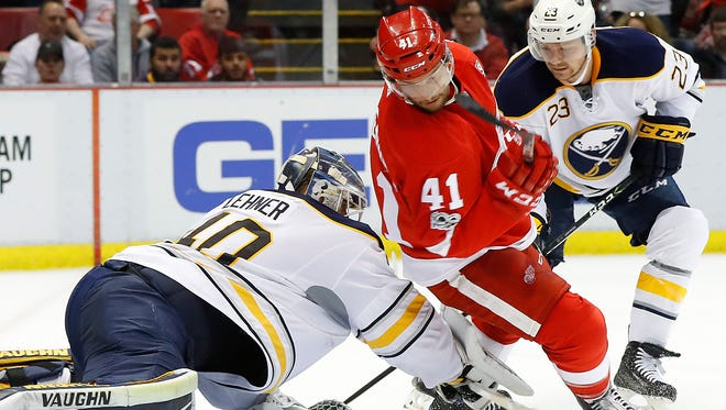 Sabres goalie Robin Lehner (40) stops a shot as Red Wings center Luke Glendening (41) tries for a rebound in the second period Monday at Joe Louis Arena.