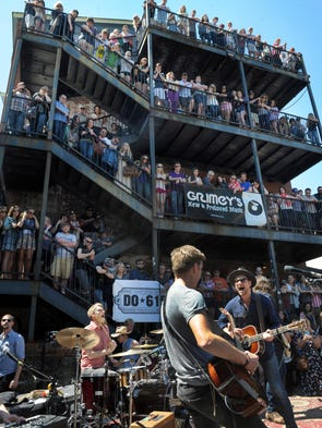 People pack Grimey's Record Store Day celebration as Needtobreathe plays on Saturday.
