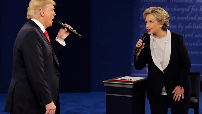 In this Sunday, Oct. 9, 2016, file photo, Republican presidential nominee Donald Trump and Democratic presidential nominee Hillary Clinton speak during the second presidential debate at Washington University in St. Louis.