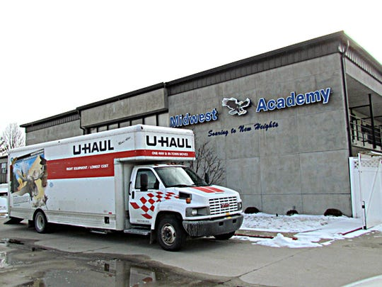 A U-Haul is parked outside Midwest Academy in Keokuk, Iowa, on Thursday, Feb. 11, 2016.