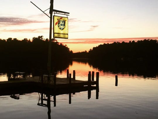 The sun setting on Clear Water Harbor Waterfront Restaurant.