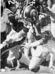 Iowa defensive back Bobby Stoops falls on a fumble during the 1979 Cy-Hawk football game in Iowa City. The Hawkeyes won, 30-14.
