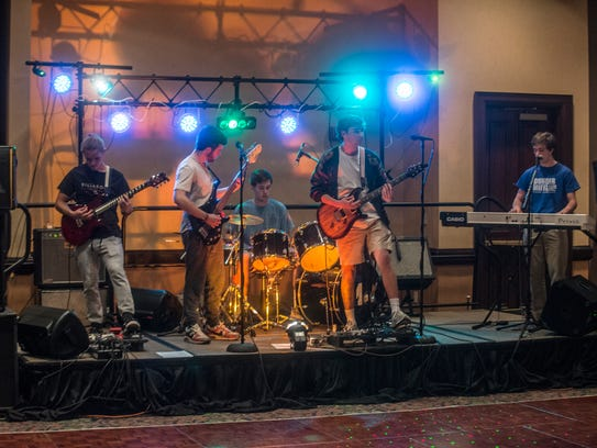 Members of the band The Talismen perform Feb. 25, 2017,