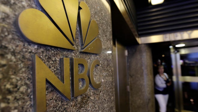 The NBC logo on the GE Building, 30 Rockefeller Plaza, in New York,  Monday, July 29, 2013.  (