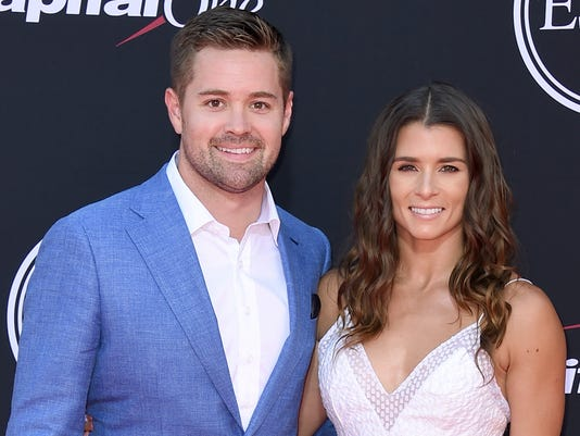 "FILE - In this July 12, 2017, file photo, NASCAR drivers Ricky Stenhouse Jr., left, and Danica Patrick arrive at the ESPYS in Los Angeles.  Danica Patrick and Ricky Stenhouse Jr. have ended their nearly five-year relationship. A spokeswoman for Patrick confirmed to The Associated Press on Monday, Dec. 18, 2017,  that the race car drivers ""are no longer in a relationship.""(Photo by Jordan Strauss/Invision/AP, File)"