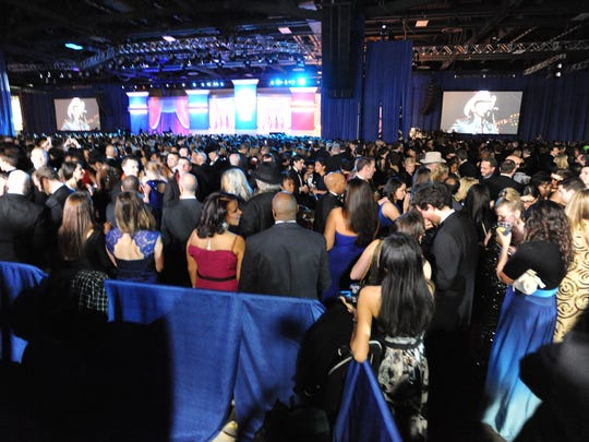 Party-goers mingle at the inaugural ball in 2013.