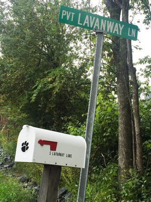A mailbox and private road sign stand outside the Jericho property where a woman was bitten by two dogs on August 26, 2015.