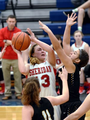 Sheridan's Jayden Geary takes a short in the lane against Miami Trace
