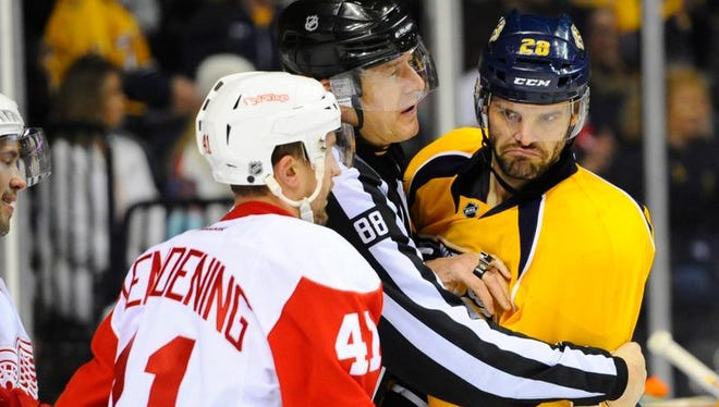 Predators center Paul Gaustad (28) is separated from Red Wings right wing Luke Glendening (41) in the second period Saturday.