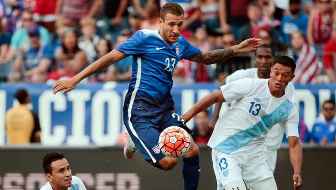 United States midfielder Fabian Johnson moves between Guatemala defenders Carlos Castrillo (13) and Ruben Morales (2) Friday in Nashville.
