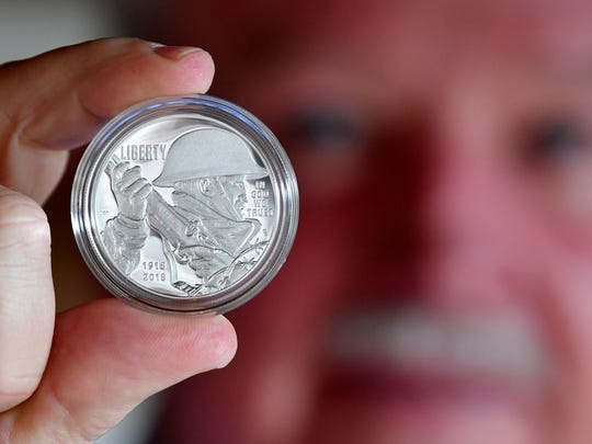 Retired Col. Gerald York was able to strike the first coin of his grandfather, Alvin C. York, during a ceremony in Philadelphia recently. The new $1 coin features York's chiseled jawline and heavy mustache.