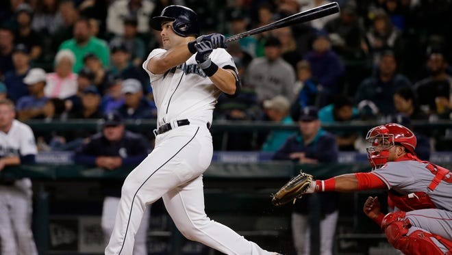 Seattle Mariners' Jesus Montero watches his three-run home run against the Los Angeles Angels during the fourth inning of a baseball game, Wednesday, Sept. 16, 2015, in Seattle.