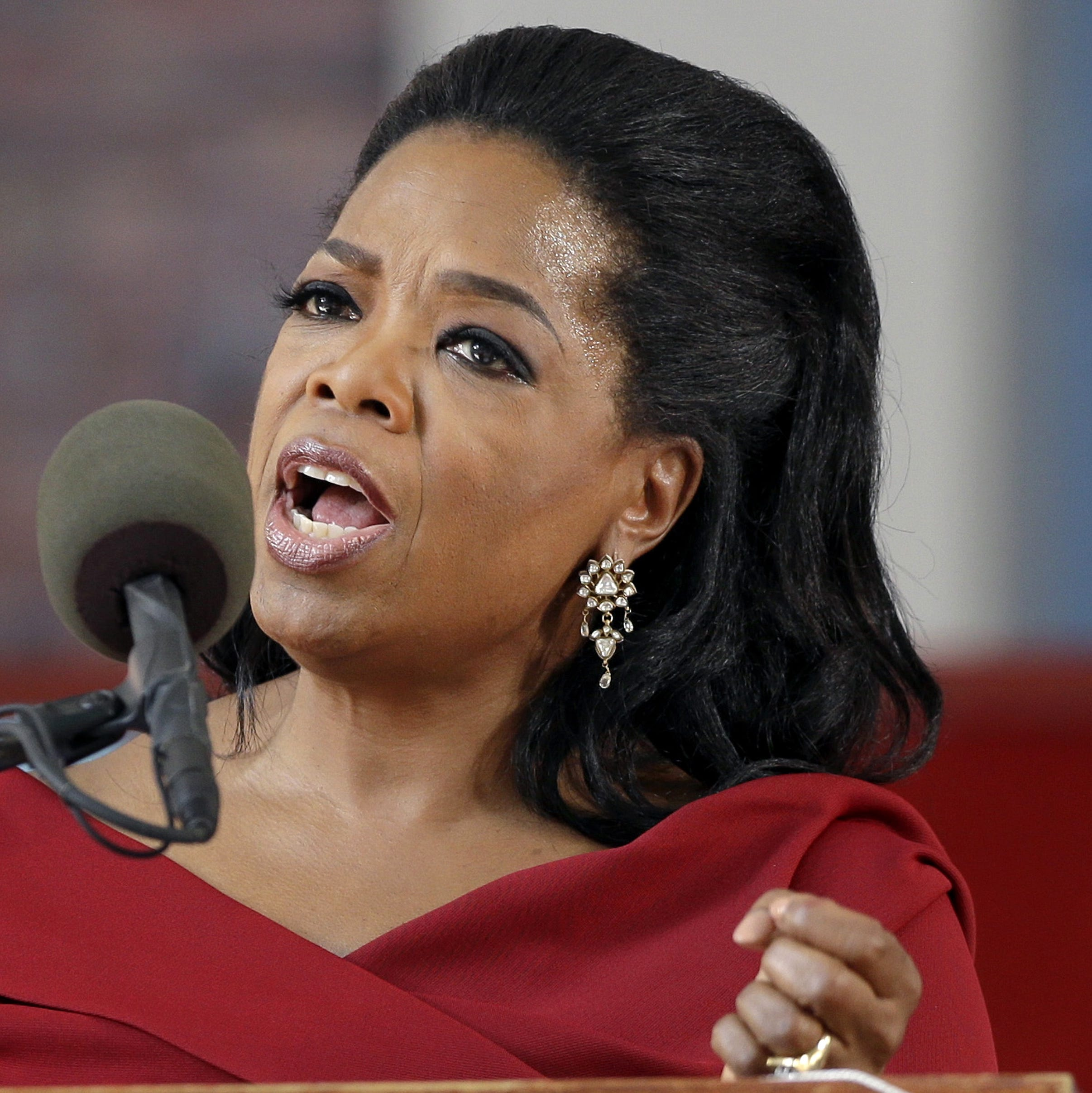 """Oprah Winfrey speaks during Harvard University's commencement ceremonies in Cambridge, Mass., in May 2013.  Winfrey says she had a racist encounter while shopping in Switzerland and the apologetic national tourist office agrees. The billionaire media mogul told the U.S. program """"Entertainment Tonight"""" that a shop assistant in Zurich refused to show her black handbag because it was """"too expensive"""" for her. She was in town to attend last month's wedding of her longtime pal Tina Turner, who lives in a Swiss chateau along Lake Zurich. Forbes magazine estimates that Winfrey earned $77 million in the year ending in June."""