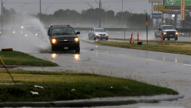 Vehicles splash through puddles on South Clack Street and on the Winters Freeway Wednesday Sept. 27, 2017. Abilene has received nearly 4 inches of rain this week.