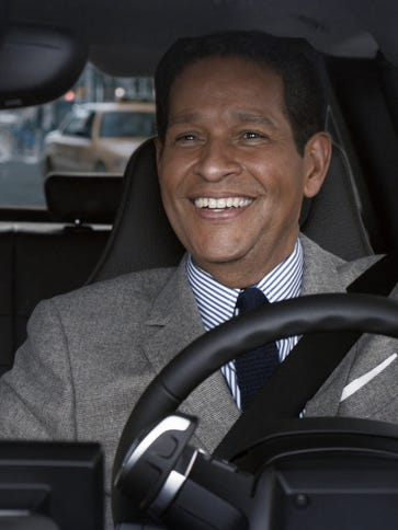 Bryant Gumbel and Katie Couric in their awesome BMW