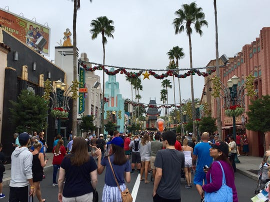 Patrons walk down Hollywood Boulevard at Disney's Hollywood Studios.
