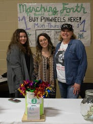 Alana Larmer, center, with volunteers at a fundraiser