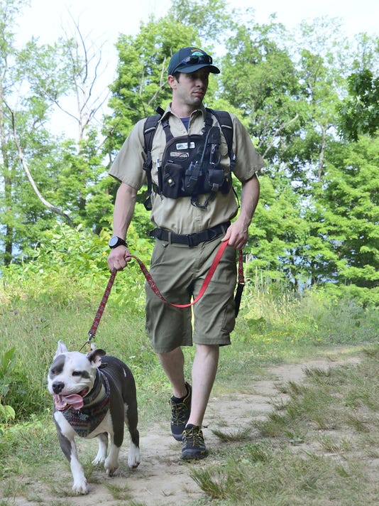 Mohonk Preserve Chief Ranger Andrew Bajardi is shown hiking with his dog, Little.