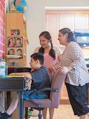Alicia Gonzalez-Lopez, right, watches as her children,