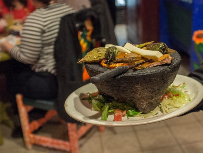 This dish called Molcajete, features steak, chicken