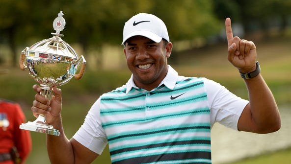 Jhonattan Vegas (VEN) with the champions trophy after