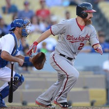 Sep 3, 2014; Los Angeles, CA, USA; Washington Nationals first baseman Adam LaRoche (25) at bat in the fourteenth inning at Dodger Stadium. Nationals won 8-5 in fourteen innings. Mandatory Credit: Jayne Kamin-Oncea-USA TODAY Sports