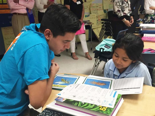 Osbaldo Vasquez with young reader at Eden Park Elementary.