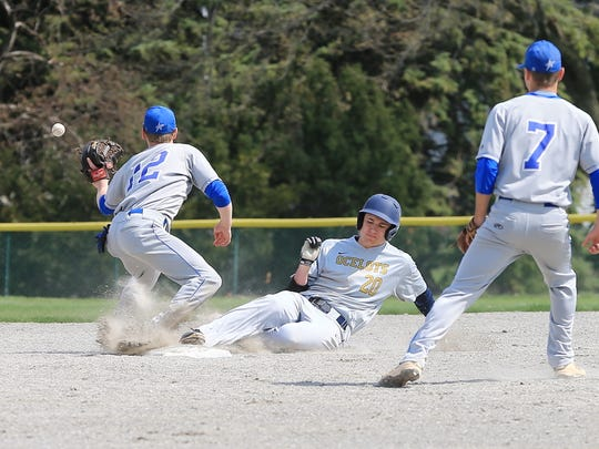 Sliding into second base for Schoolcraft during an April contest is David Chavez (20).
