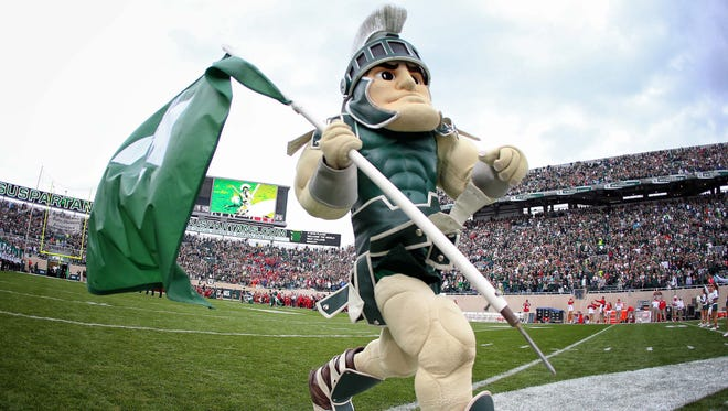 Michigan State Spartans mascot 'Sparty' takes the field prior to a game against the Indiana Hoosiers at Spartan Stadium.