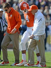 Clemson quarterback Deshaun Watson (4) is helped off