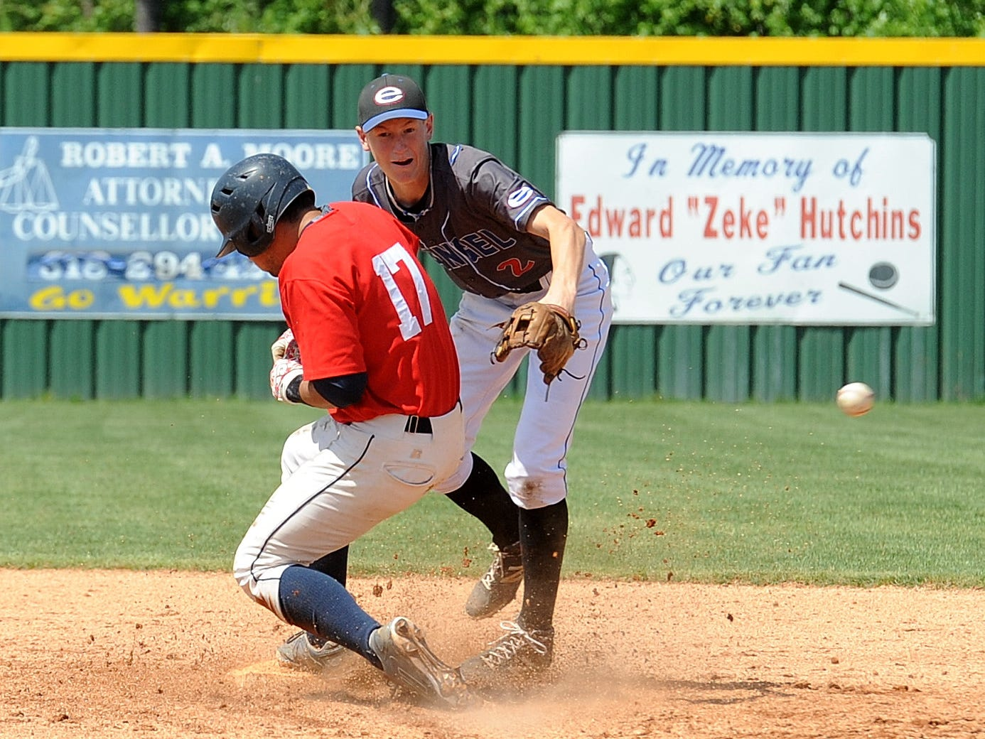 Evangel's Collin Beckermeyer attempts to turn a double play against Lakeside on Saturday.
