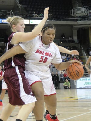 Holmes senior Maurissa Brown tries to get past a defender.