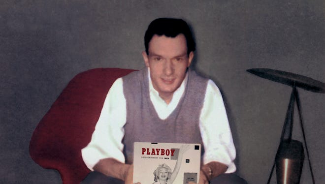 Hugh Hefner holds the inaugural issue of 'Playboy' mag, December 1953.