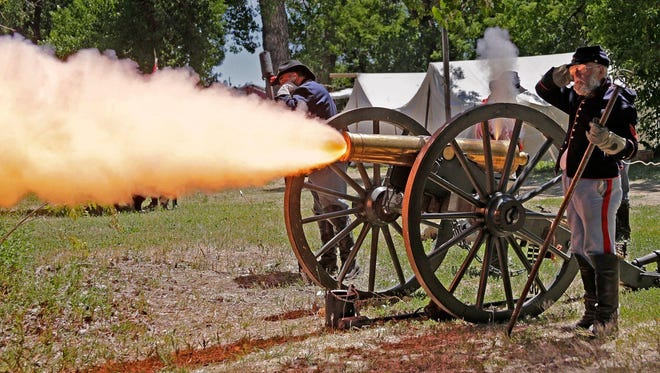 In this June 22, 2016 photo, a historic 12-pound howitzer from Fort Phil Kearny in Wyoming is fired at the U.S. Cavalry School in Crow Agency.
