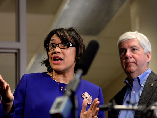Gov. Rick Snyder and Flint Mayor Karen Weaver meet with the press after a January 2016 meeting to discuss the next steps in regards to Flint's water crisis.