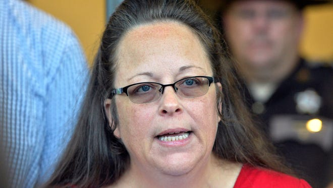 "Rowan County Clerk Kim Davis refused to issue marriage licenses to same-sex couples, saying it was against her religious beliefs. She has sued Kentucky's governor, claiming he ""usurped' county-level authority in granting marriage licenses."