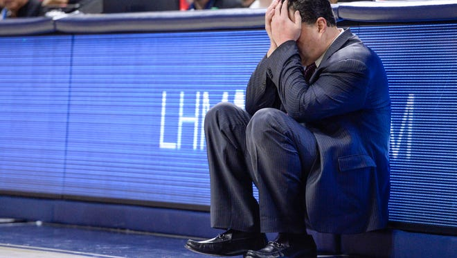 Arizona Wildcats head coach Sean Miller sits with his head in his hands during the second half against Oregon on Jan 13, 2018 at McKale Center.