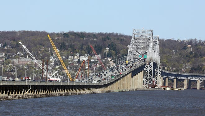 Cranes at the Tappan Zee Bridge construction site April 24. A new bus system in Westchester and Rockland is expected to be place when the new Tappan Zee Bridge is completed in 2018.