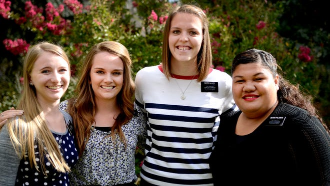 Sisters Emily Wirick, 19, (from left), Courtney, Kinneard, 19, Ashley Alvey, 19, and Ma'ata Palanite, 20, of the Church of Jesus Christ of Latter-day Saints are serving a mission in Salem. The minimum age to be allowed to do missionary work was lowered to 19 recently, allowing more young women to participate.