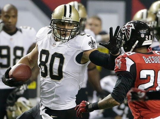 FILE - In this Nov. 21, 2013 file photo, New Orleans Saints tight end Jimmy Graham (80) tries to get past Atlanta Falcons free safety Thomas DeCoud (28) during the second half of an NFL football game in Atlanta. The Saints have confirmed a multiyear contract with star tight end Jimmy Graham. (AP Photo/John Bazemore, File)