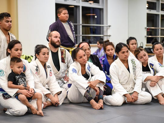 Students watch a demonstration at the Figo'/Bonsai