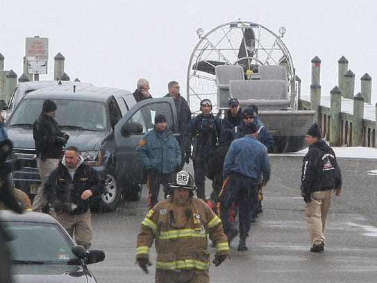 Rescue crews gather March 1, 2015, in Pine Beach to
